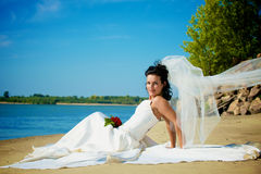 Young bride on the beach Stock Images