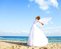Young bride on the beach Stock Photos