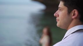 Young bride on the beach near sea at the evening or sunsetposing. Romantic near ocean. stock video