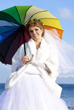 Young bride on the beach with umbrella Stock Image