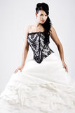 Young bride in black and white wedding dress Royalty Free Stock Image