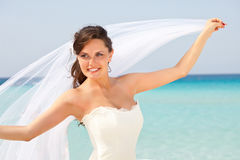 Young bride and blue sea Stock Photography