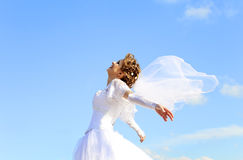 Young bride at blue sky background Royalty Free Stock Photography