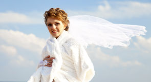Young bride at blue sky background Stock Images