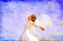 Young bride at blue sky background. Stock Photo