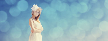 Young bride at blue sky background. Royalty Free Stock Image