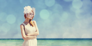 Young bride at blue sky background. Stock Images