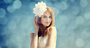 Young bride at blue sky background. Royalty Free Stock Photography