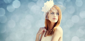 Young bride at blue sky background. Royalty Free Stock Photos