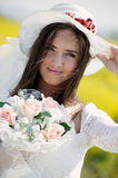 Young bride with bouquet. Portrait of a young woman in a wedding dress holding a bouquet of flowers Stock Photo