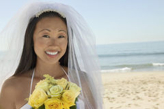 Young Bride With Bouquet On Beach Royalty Free Stock Photo