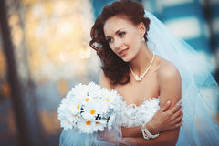 Young bride with bouquet. Young beautiful bride in a wedding dress with a bouquet Stock Photo