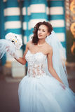 Young bride with bouquet. Young beautiful bride in a wedding dress with a bouquet Royalty Free Stock Photo