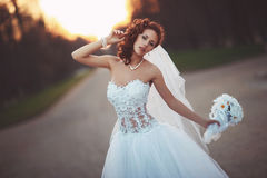 Young bride with bouquet. Young beautiful bride in a wedding dress with a bouquet Stock Image