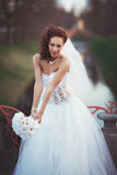 Young bride with bouquet. Young beautiful bride in a wedding dress with a bouquet Stock Photography