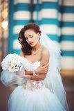 Young bride with bouquet. Young beautiful bride in a wedding dress with a bouquet Royalty Free Stock Images