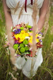 Young bride with bouquet of flowers in her hands Stock Photos