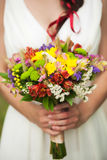Young bride with bouquet of flowers in her hands Royalty Free Stock Images