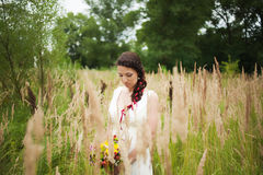 Young bride with bouquet of flowers in her hands Stock Photo