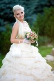 Young bride with a bouquet on the nature Stock Photo