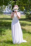 Young bride with bouquet on nature Stock Photography