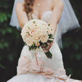 Young bride with bouquet of white roses Stock Photos