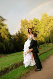 Young bride with bridegroom. Young bride and the bridegroom in the park royalty free stock photos