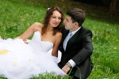 Young bride with bridegroom. Young bride and the bridegroom in the park royalty free stock photography