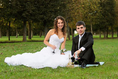 Young bride with bridegroom. Young bride and the bridegroom in the park stock image