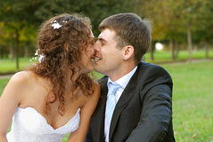 Young bride with bridegroom. Young bride and the bridegroom in the park royalty free stock photo