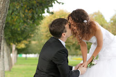 Young bride with bridegroom. Young bride and the bridegroom in the park stock images