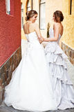 Young Bride And Bridesmaid in an Alleyway Royalty Free Stock Image