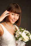 Young bride with the bunch of flowers Royalty Free Stock Images