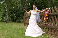 Young bride catches the bubbles Stock Photography