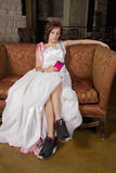 Young Bride On Couch Wearing Tennis Shoes Royalty Free Stock Images