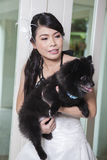 Young bride and Dog Royalty Free Stock Photography