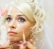 Young bride doing wedding make up Stock Photos