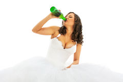 Young bride drinking beer Royalty Free Stock Image
