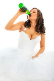 Young bride drinking beer Royalty Free Stock Images