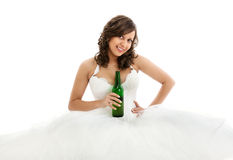 Young bride drinking beer Royalty Free Stock Photo