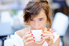 Young bride drinking coffee at the outdoors cafe Stock Photo
