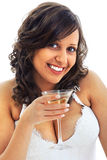 Young bride drinking martini Stock Images