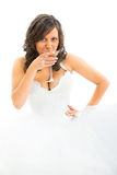 Young bride drinking martini Stock Photography