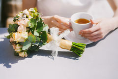 Young bride drinking tea Royalty Free Stock Photography