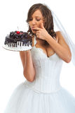 Young bride eating cake Royalty Free Stock Photography