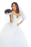 Young bride eating cake Royalty Free Stock Image