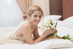 Young bride in elegant hotel room Royalty Free Stock Images