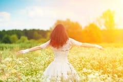 Young bride enjoying the sun Stock Photo