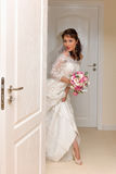Young bride entering the room Stock Images