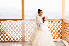 Young bride with the flower bouquet in winter time Stock Image